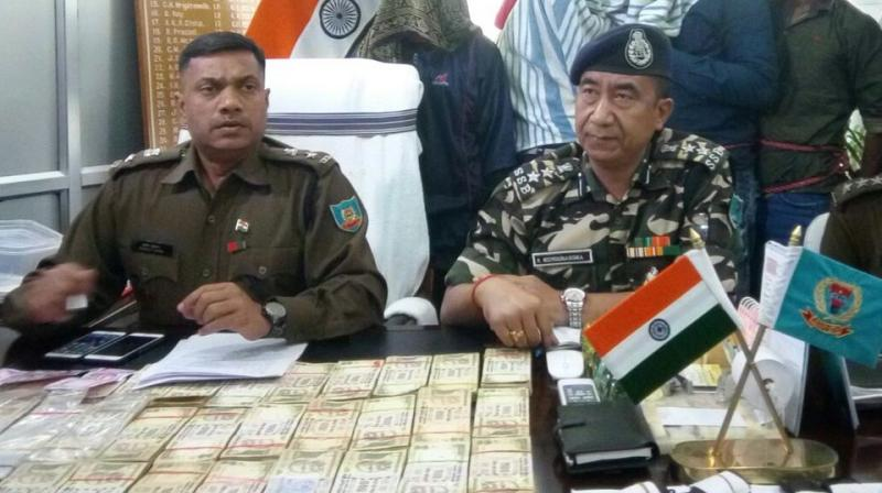 Police with the money seized from the Maoists. (Photo: ANI/Twitter)