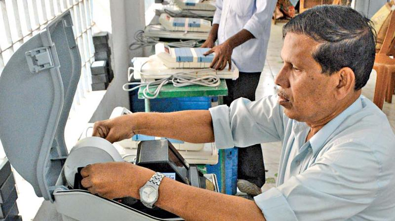 Poll officials check the voter-verified paper audit trail machines to be used for RK Nagar election at Pulianthope corporation school. (Photo: DC)