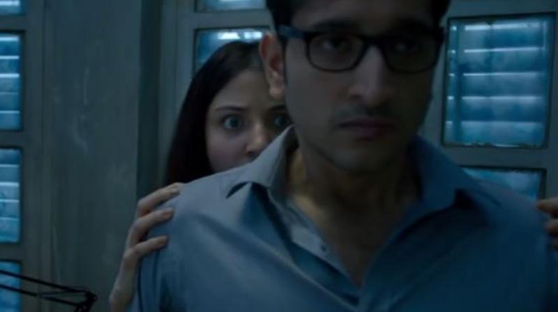A screenshot of Anushka Sharma and Parambrata Chatterjee from 'Pari' trailer.