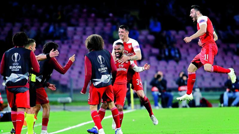 Arsenal's Alexandre Lacazette (third from right) celebrates with his teammates after scoring against Napoli during the Europa League second leg quarterfinal match at San Paolo stadium in Naples, Italy, on Thursday. Arsenal won 1-0 to progress 3-0 on aggregate. (Photo: AP)