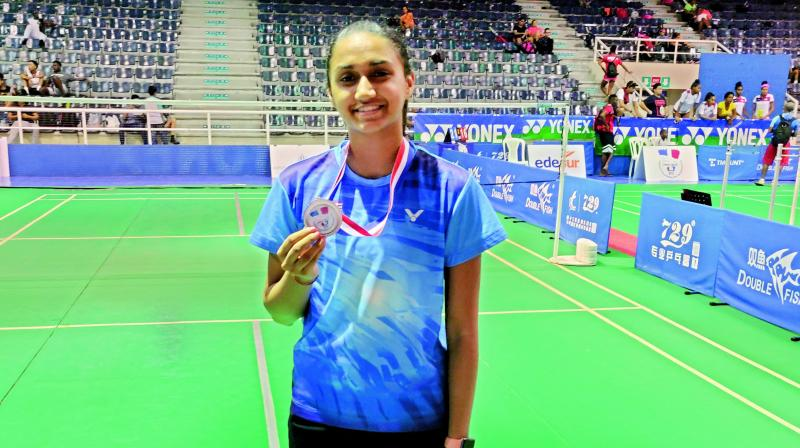 Ruhi Raju poses with her silver medal from the Santo Domingo International Series badminton at Santo Domingo, Dominican Republic.