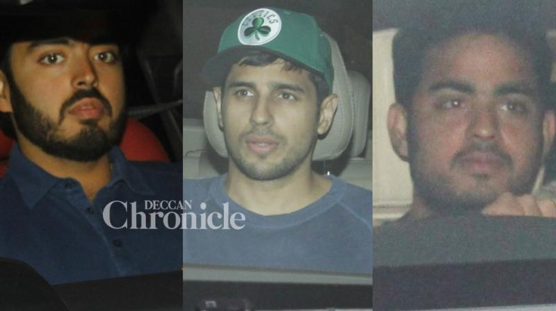 Sidharth Malhotra and the younger generation of Ambani family were snapped arriving at Karan Johar's house in Mumbai for a bash late Sunday. (Photo: Viral Bhayani)