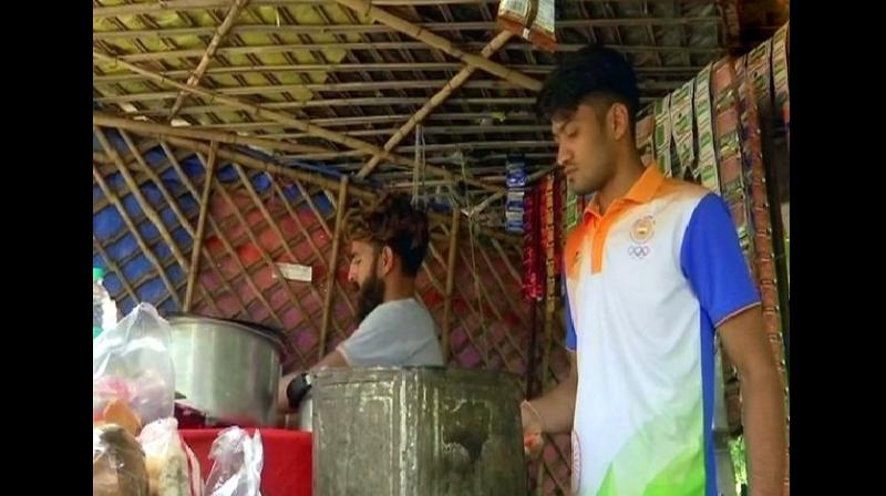 Harish Kumar, member of Indian Sepak Takraw team that won abronze medal at the Asian Games 2018, has resumed his job of selling tea at his father's shop to support his family. (Photo: ANI)