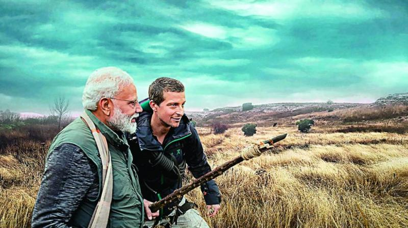 An undated image provided by Discovery channel shows PM Narendra Modi featuring in the channel's popular franchise Man Vs Wild with world renowned survivalist and adventurer Bear Grylls. (Photo: PTI)