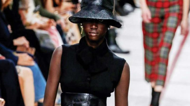 A model wearing a bucket hat and leather cumberband at the Dior's tartan-heavy Paris autumn winter show.