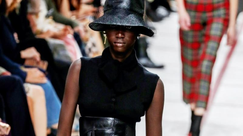 A model wearing a bucket hat and leather cumberband at the Dior's tartan-heavy Paris autumn winter show. (Photo: AFP)