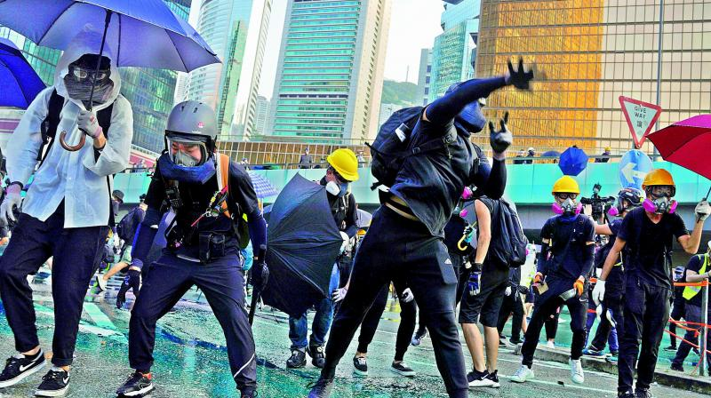 The violence has hit pockets of Hong Kong at different times over more than three months, allowing life to go on as normal for the vast majority most of the time. (Photo: AP)
