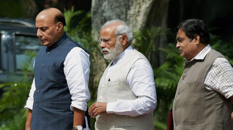 Prime Minister Narendra Modi along with Home Minister Rajnath Singh and Transport Minister Nitin Gadkari. (Photo: PTI/File)