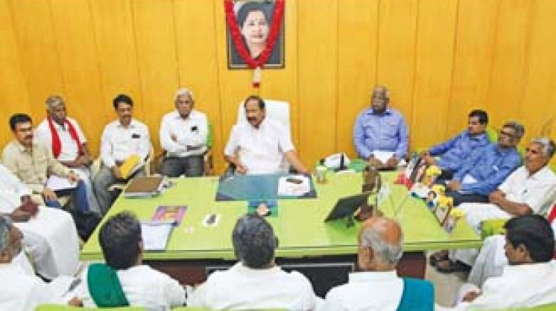 Electricity Minister P. Thangamani holding talks with the farmers in Chennai on Friday. (Image DC)