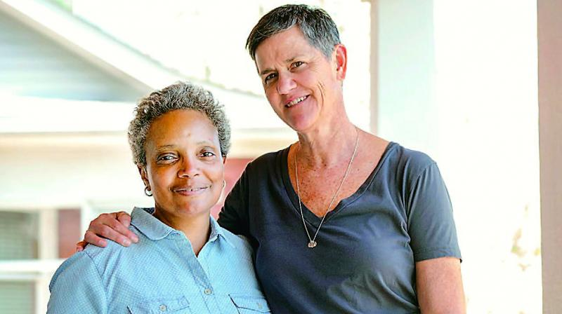 Lori Lightfoot, the first black woman and first openly gay mayor of the third largest US city of Chicago along with her partner Amy Eshleman.