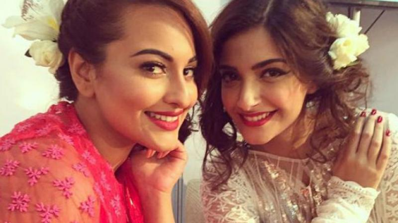 Sonakshi Sinha and Sonam Kapoor at an event.