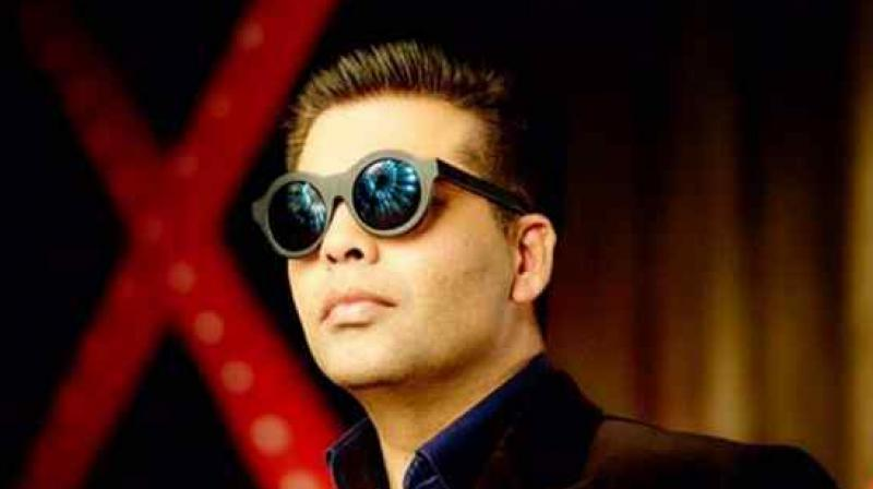 Karan Johar spotted at an event.
