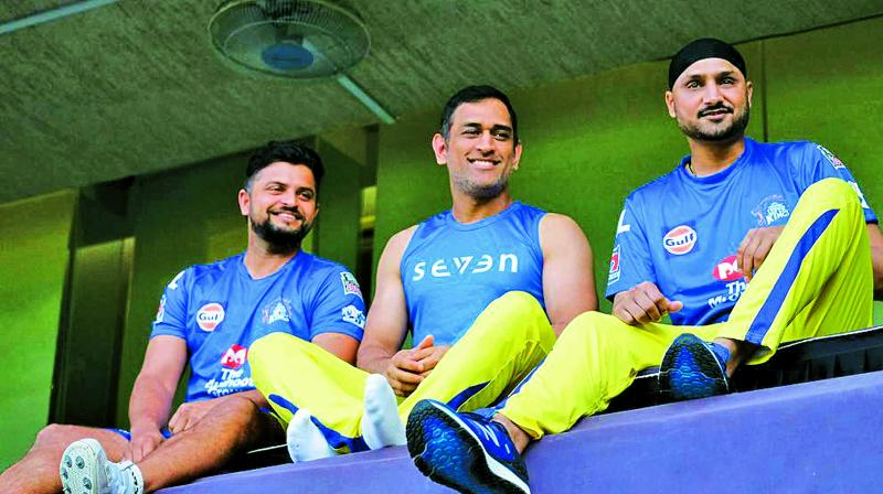 Suresh Raina, M.S. Dhoni and Harbhajan Singh pose from the Wankhede dressing room balcony as they reminisce India's 2011 World Cup triumph. (Photo: Twitter)
