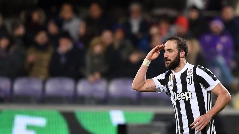 Higuain is the only player who has moved initially on loan, with Milan paying 18 million euros ($21 million) for the services of the 30-year-old Argentina forward for next season. (Photo: AFP)