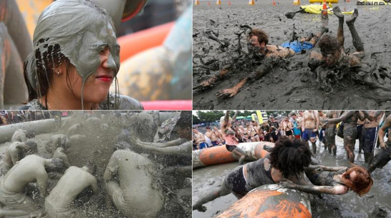 The 20th annual mud festival features mud wrestling and mud sliding. (Photo: AP)