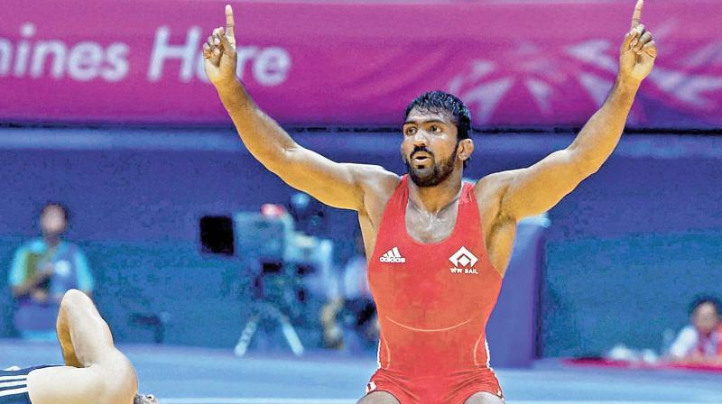 Yogeshwar  celebrates a win.