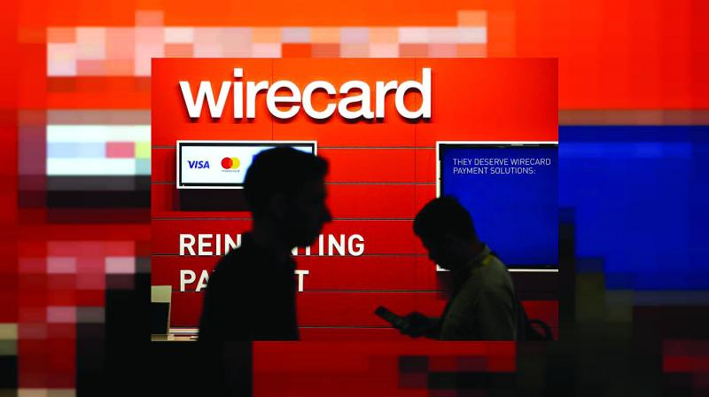 Wirecard said its network of 15,000 retail agents in 350 cities would help collect and scan in the documents that people need to apply for a PAN card.