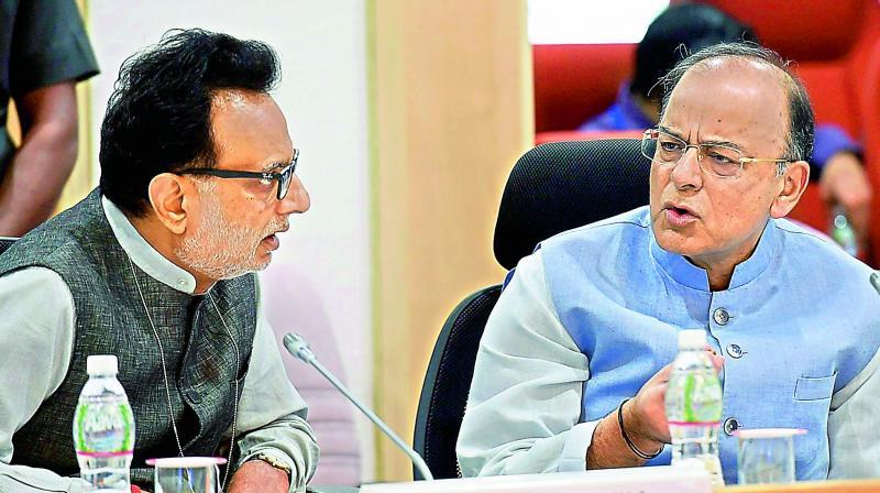 Revenue Secretary Hasmukh Adhia and Finance Minister Arun Jaitley. (Photo: AP)