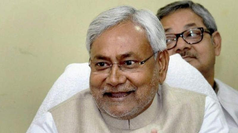 """Bihar Chief Minister Nitish Kumar claimed, before the quick-paced developments plunged Bihar into a political turmoil, a """"behind the scene game"""" was being played out where JD(U) MLAs were being 'lured' to defect."""