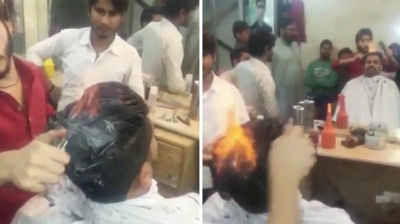 The barber applies a cream and powder and styles the hair while it is on fire. (Photo: Twitter)