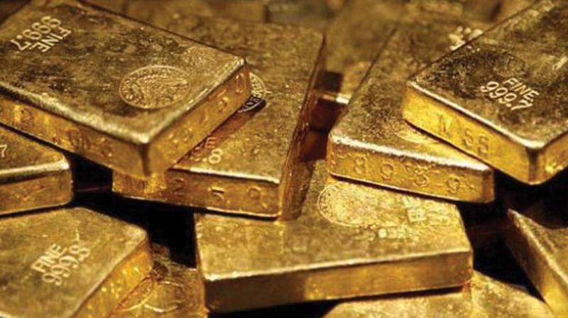 Globally, spot gold was trading lower at USD 1,408.57 an ounce after hovering near six-year highs on Tuesday, while silver was down at USD 15.22 an ounce in New York.