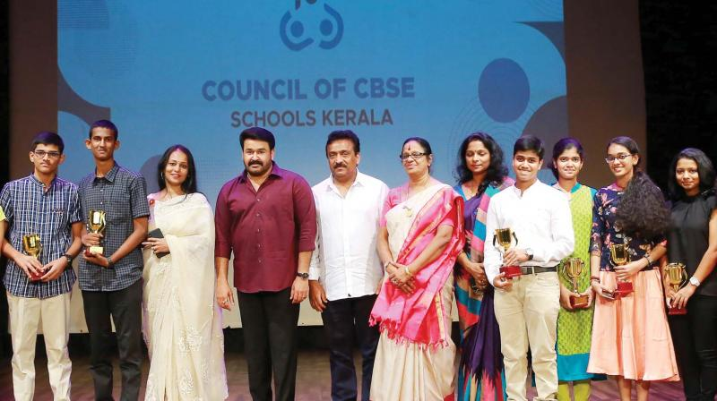 Mohanlal with CBSE rankholders after a felicitation event organised by the Council of CBSE Schools Kerala. Office-bearers of the council are also seen.
