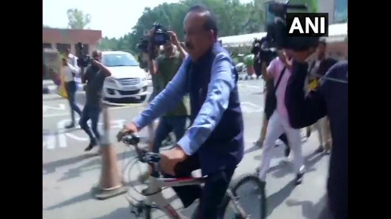 The Minister of Health and Family Welfare was photographed while riding to office, dressed in formals. (Photo: ANI)