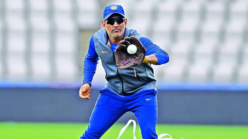 M.S. Dhoni during a training session on Monday.  — AP