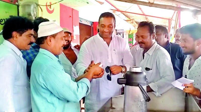 Mekapati Gautham Reddy with his followers at the tea shop of his fan Aziz Bhai at Atmakur.