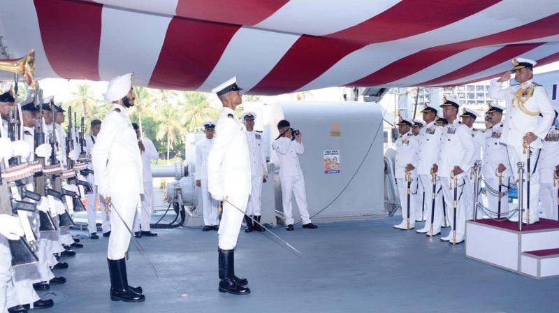 Rear Admiral R.J. Nadkarni reviewes the passing out ceremony