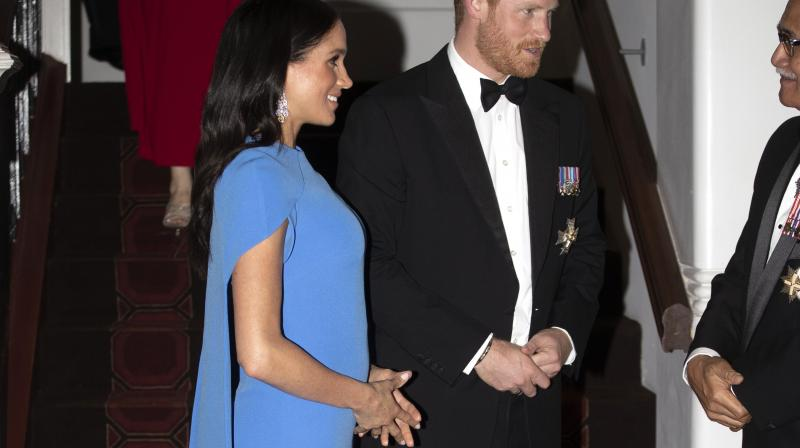 Britain's Prince Harry and Meghan, Duchess of Sussex at the official dinner in Suva, Fiji, Tuesday, Oct. 23, 2018. Prince Harry and his wife Meghan are on day eight of their 16-day tour of Australia and the South Pacific. (Photo: AP)
