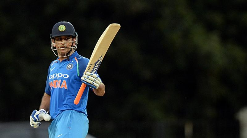 Having Dhoni, whose 341 ODI appearances makes him the most experienced player at this year's World Cup, at number five would ensure the former India captain could nudge along before exploding in the final overs, believes Tendulkar. (Photo: AFP)