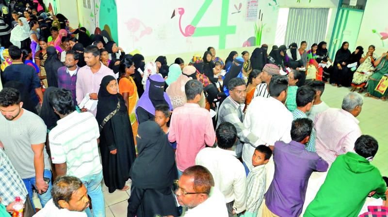Suffering from fever, patients in large numbers wait at the Golkonda Area Hospital on Tuesday.  (Photo: P. Surendra)