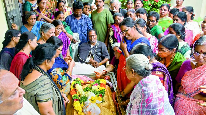 Family members mourn near the body of Sivajyothi, a Uppal resident who died in the tragedy, on Tuesday. (Photo: DC)