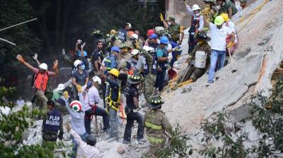 A powerful earthquake shook central Mexico on Tuesday, collapsing buildings in plumes of dust and killing at least 248 people.
