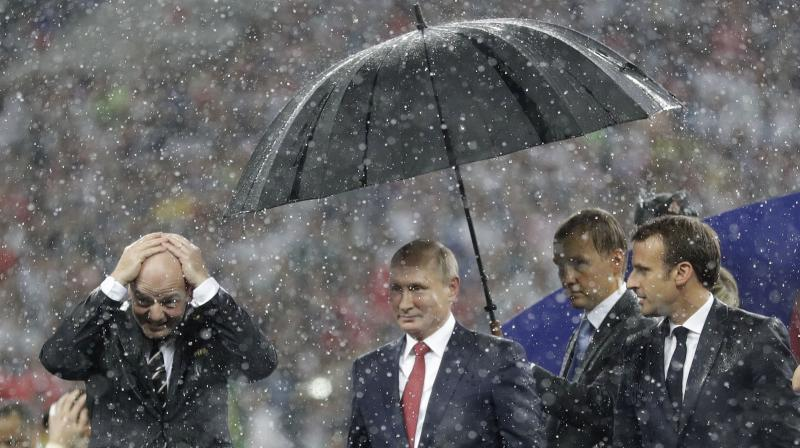 A fierce downpour followed as both the teams were presented with the medals. (Photo: AP)