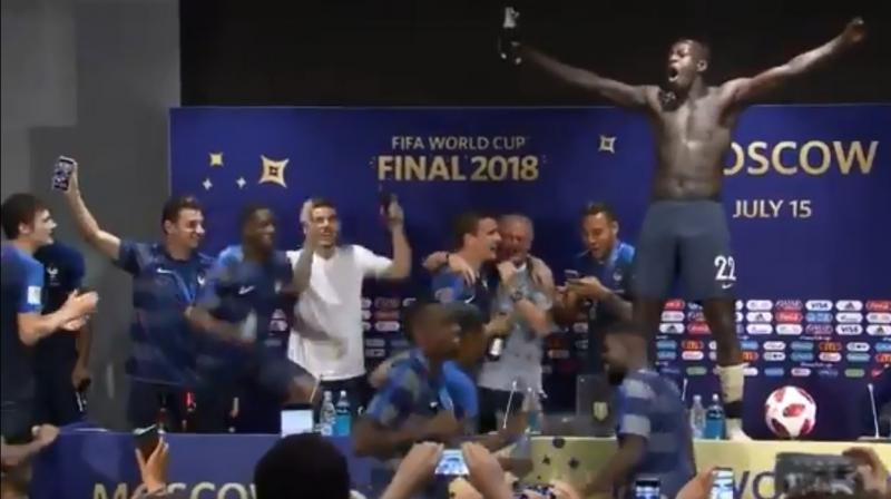 Paul Pogba and Benjamin Mendy led the charge, drenching their boss in champagne and a few other journalists present.(Photo: Screengrab)
