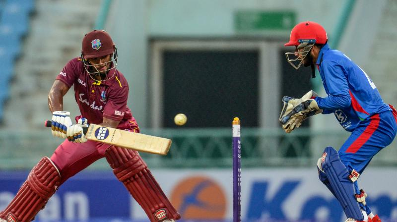 Nicholas Pooran scored highest runs for Windies as he played a knock of 67 runs before giving away his wicket to Naveen ul-Haq in the 50th over. (Photo:AFP)