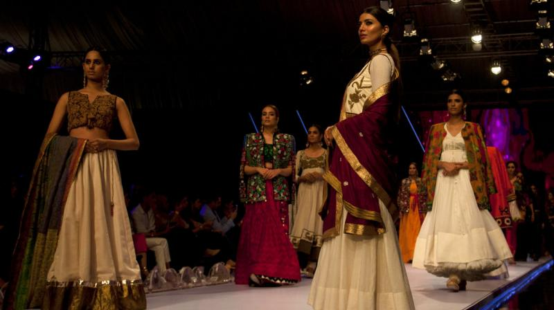 From Maheen Khan's Gulabo to Huma Adnan's muted creations and Cheena Chhapra making senior citizens walk on ramp, PFW displayed array of creations and sensibilities. (Photo: AP)