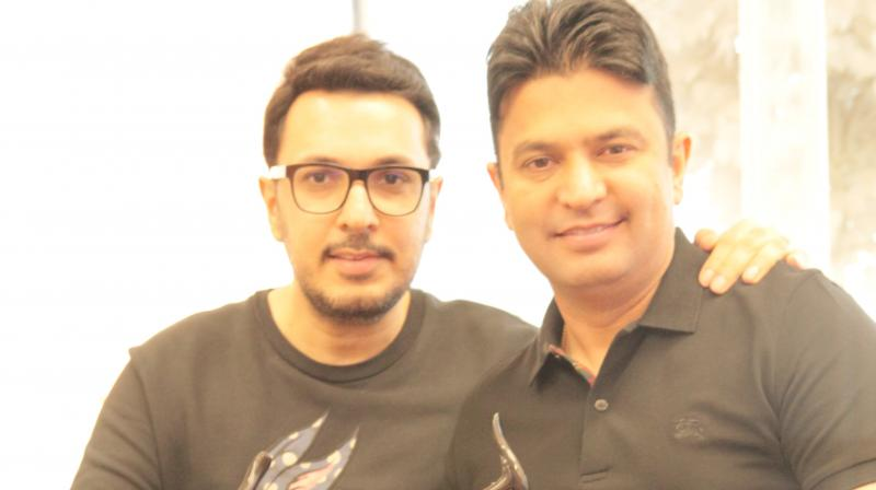 Dinesh Vijan and Bhushan Kumar pose with their Filmfare Award.
