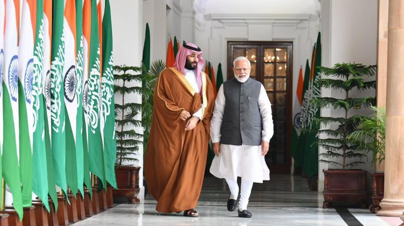 Prime Minister Narendra Modi walks with Saudi Crown Prince Mohammad bin Salman ahead of bilateral talks.(Photo: @MEAIndia | Twitter)