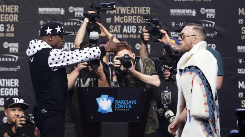 Floyd Mayweather and Conor McGregor are set to face each other in a boxing ring in Las Vegas on August 26 in what could be the richest fight in history. (Photo: AP)