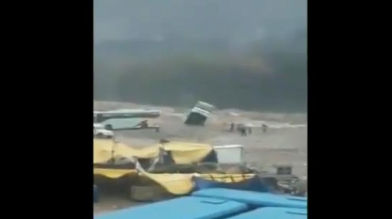 The bus was empty when it was washed away into the flooded Beas River. (Photo: Screengrab | ANI)