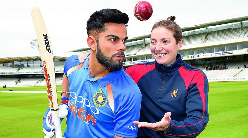 A member of the staff gets up close to Madame Tussauds London's newly unveiled figure of Virat Kohli at Lords Cricket Ground. The figure will be available for guests to see at the world-famous attraction from Thursday.