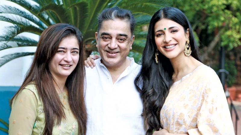 Kamal Haasan with his daughters Charu and Sruti.