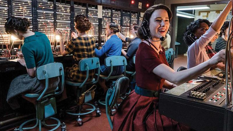A still from the series The Marvellous Mrs Maisel where she works in the communications department which she does not like but needs the job to make a living.