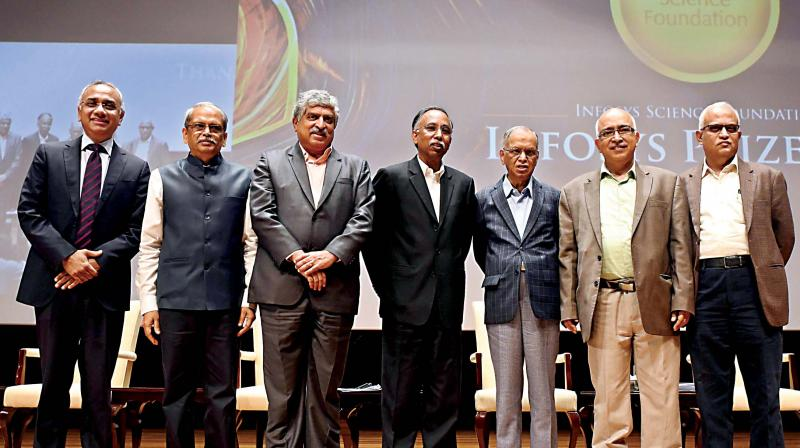 CEO and MD of Infosys Salil Parekh with Co-Founder Infosys and Trustee Kris Gopalakrishnan, Co-Founder Infosys and Non Executive Chairman of Board Nandan Nilekeni, Co-Founder Infosys and President - Board trustee S D Shibulal, Founder Infosys N R Narayana Murthy, Co-Founder Infosys and Trustee K Dinesh and Former Director Infosys and Trustee Srinath Batni during the announcement of Infosys Prize 2019 at Infosys Campus , in Bengaluru on Thursday (Photo: R Samuel)