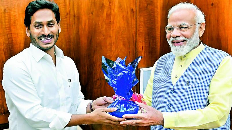 Chief Minister Y.S. Jagan Mohan offers prasadam to Prime Minister Narendra Modi in New Delhi on Tuesday.