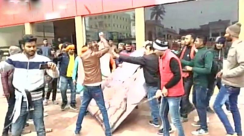 In Bihar's Muzaffarnagar some people, who identified themselves as members of the local Karni Sena unit, vandalised a cinema hall. (Photo: ANI)