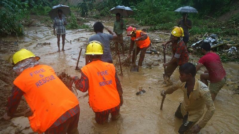 Bangladeshi fire fighters and residents search for bodies after a landslide in Bandarban Bangladeshi fire fighters and residents search for bodies after a landslide in Bandarban (Photo: AFP)